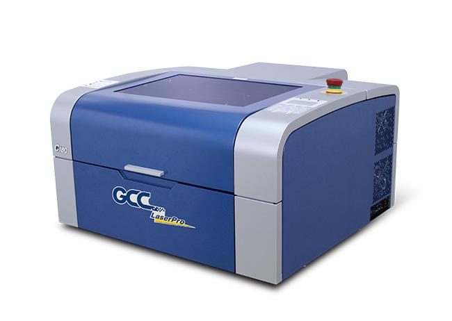 レーザーカッター(レーザー加工機)GCC LaserProシリーズC180ⅡはCO2型のレーザーで、ワークエリアがA3サイズ以上もありながら卓上にのせて、アクリル、木材、紙、布、石と多様なものに加工することができる一番人気の機種になります。